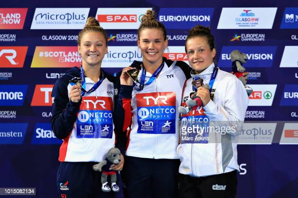 Grace Reid of Great Britain Alicia Blagg of Great Britain and Tina Punzel of Germany are presented with their medals for the Women's 3 metre...