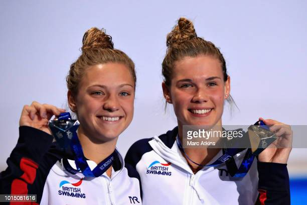 Grace Reid of Great Britain and Alicia Blagg of Great Britain celebrates with their medals from the Women's 3 metre Springboard Final during the...