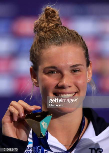 Grace Reid of Great Britain poses with her Gold medal after winning the Women's 3 metre Springboard Final during the diving on Day Ten of the...