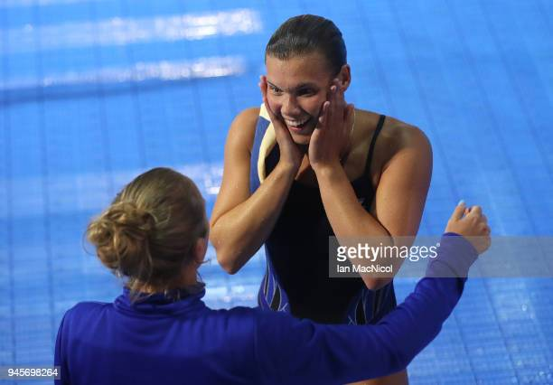 Grace Reid of Scotland is seen with her coach Jen Leeming after winning the Women's 1m Springboard final during Diving on day nine of the Gold Coast...