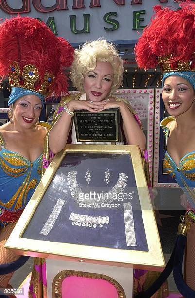 Grace Rodriguez winner of the Ringling Bros and Barnum and Bailey Circus'' Marilyn Monroe lookalike contest poses with showgirls and jewelry worn by...
