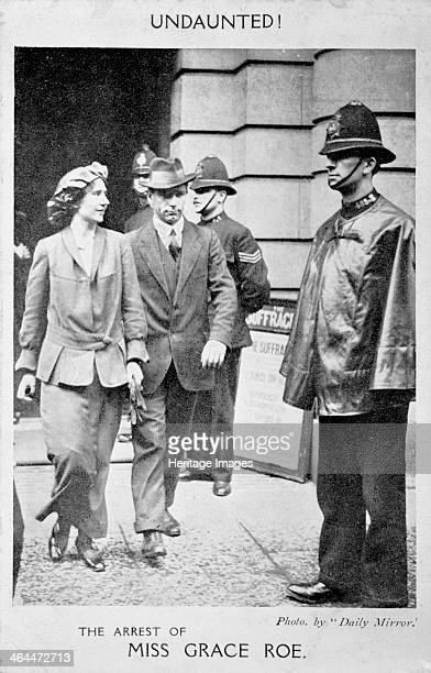 Grace Roe 23rd May 1914 Organizer and deputyleader being arrested at WSPU headquarters She is being escorted from Lincoln's Inn House charged with...