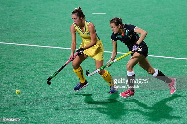 Grace Stewart of Australia and Selin Oruz of Germany chase for the ball during the TPG International Tri Series at Sengkang Hockey Stadium on January...