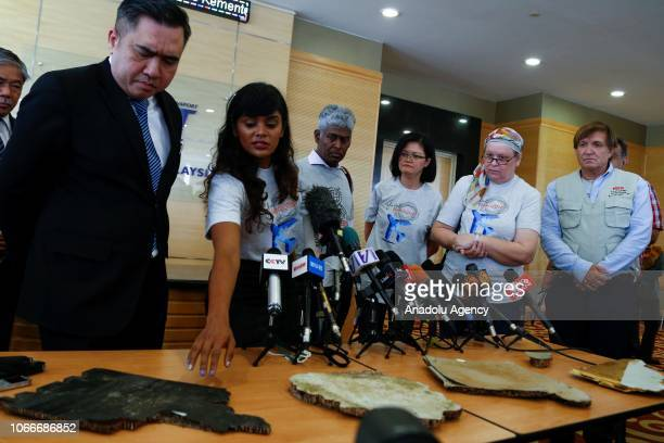 Grace Subathirai Nathan daughter of MH370 passenger Anne Daisy shows to Malaysia's Transport Minister Anthony Loke pieces of debris found in...