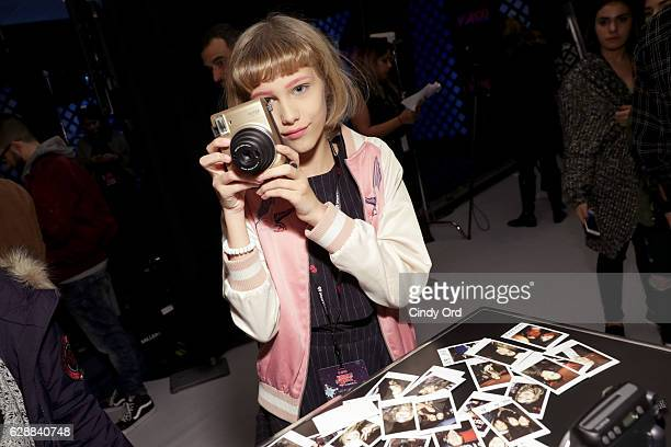 Grace VanderWaal poses with Fujifilm Instax Mini during Z100's artist gift lounge during Jingle Ball 2016 at Madison Square Garden on December 9 2016...