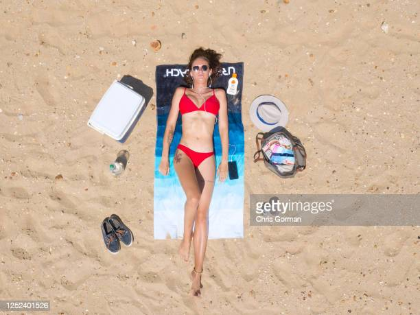 Grace Wilbrink sunbathes enjoys the sunshine on Bournemouth Beach on June 24,2020 in Bournemouth,England .The UK is experiencing a summer heatwave,...