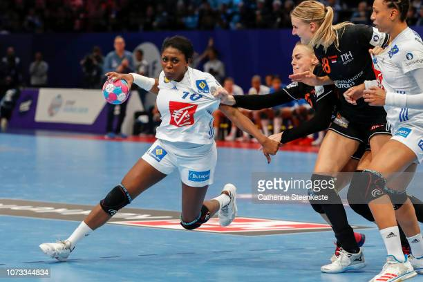 Grace Zaadi Deuna of France is trying to shoot the ball against Maura Visser and Kelly Dulfer of Netherlands during the EHF Euro semi-final match...