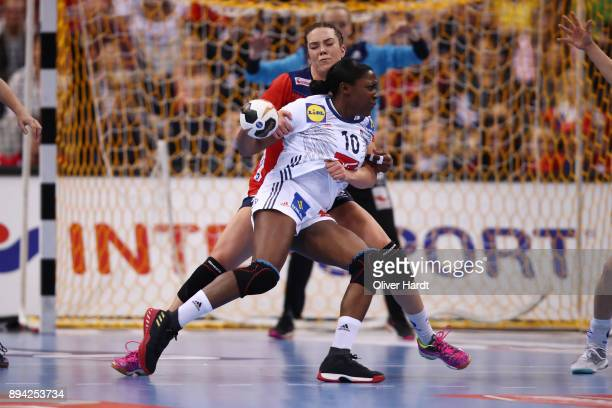 Grace Zaadi of France and Kari Brattset of Norway challenges for the ball during the IHF Women's Handball World Championship final match between...