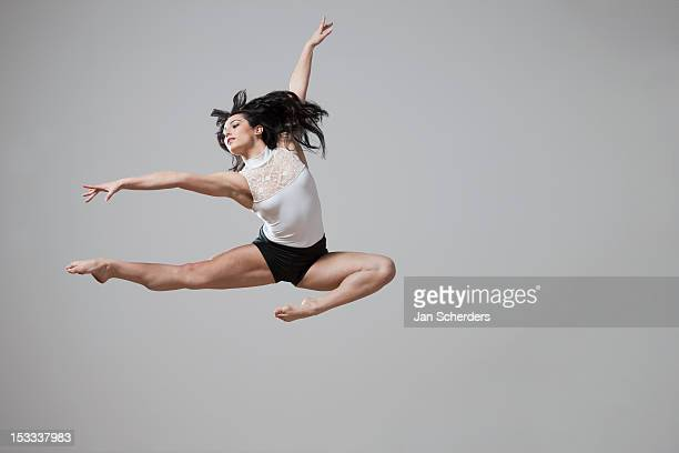 Graceful Caucasian ballet dancer in mid-air