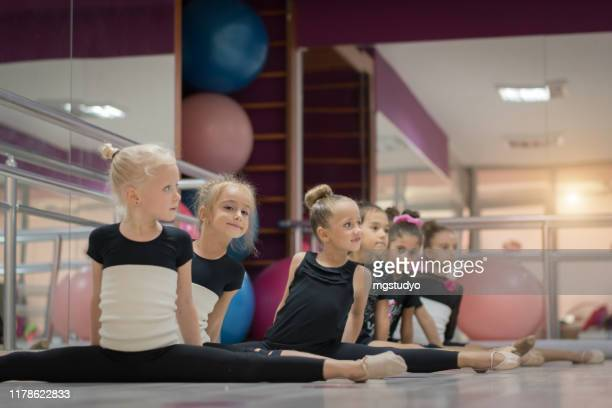 graceful little ballet girls doing the splits - rhythmic gymnastics stock pictures, royalty-free photos & images