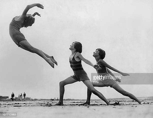 A graceful pose by the Margarter Morroa dancers on the beach at WestonsuperMare in Somerset England in the 1970's