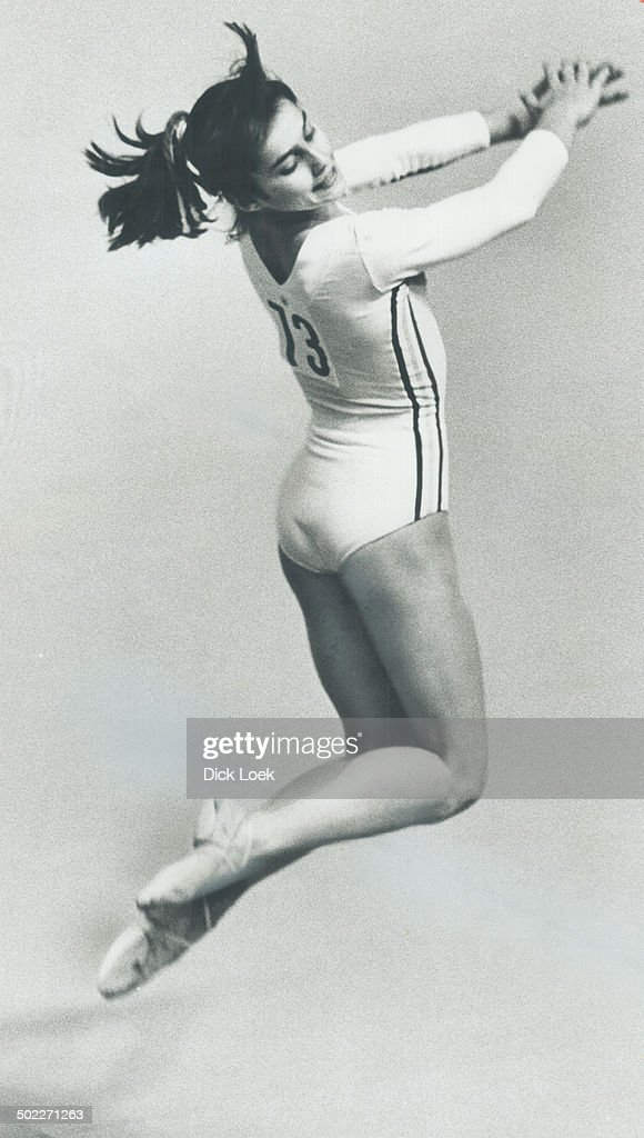 On her way to best allround gymnastics performance in Olympic history, Nadia Comaneci delights the Forum audience yesterday with her floor exercises.