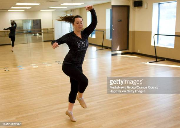 Gracie Doran warms up before a class at South Coast Conservatory. Doran suffered a stroke at age 10 that left half of her body paralyzed but has used...