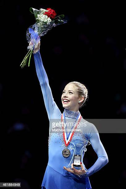Gracie Gold celebrates on the medals podium after winning the ladies competition at the Prudential US Figure Skating Championships at TD Garden on...