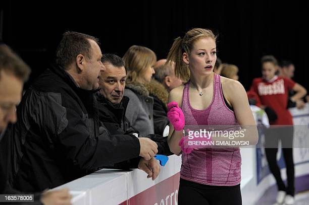 Gracie Gold of the US talks to coaches while practicing at Budweiser Gardens in preparation for the 2013 World Figure Skating Championships in...