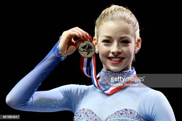 Gracie Gold poses on the medals podium after winning the ladies competition at the Prudential US Figure Skating Championships at TD Garden on January...