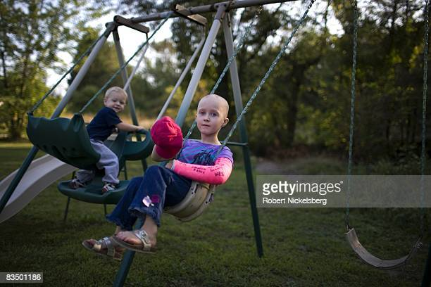 Gracie Hartle 6 years plays on her swing set with her younger brother Chase 3 years on September 11 2008 in Shippingport Pennsylvania Gracie is...