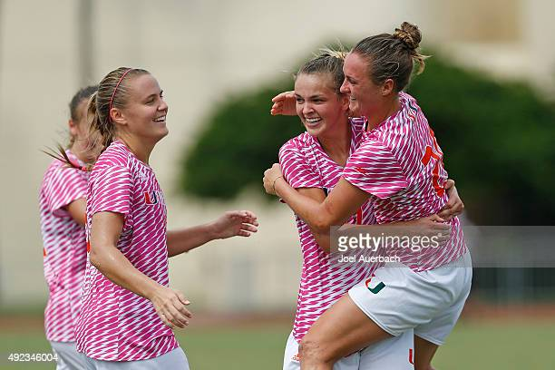 Gracie Lachowecki celebrates her second goal of the game with Erin McGovern and Amy Schmidt of the Miami Hurricanes against the North Carolina State...