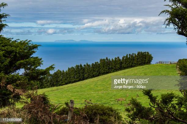 graciosa island on the horizon - atlantic islands stock pictures, royalty-free photos & images