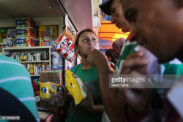 Gracy from Venezuela waits to purchase food after travelling 14 hours from her town to cross the border into Colombia on October 4 2016 in Cucuta...