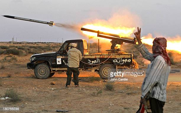 A Grad rocket is launched from a homemade launcher placed on a Toyota Land Cruiser built in Misrata on October 12 2011 in Sirte Libya Fighting in...