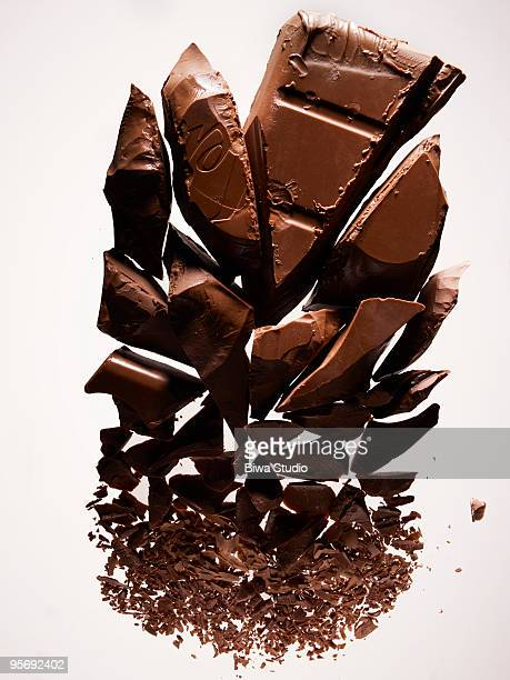 gradation of pieces of chocolate - chocolate pieces stock photos and pictures