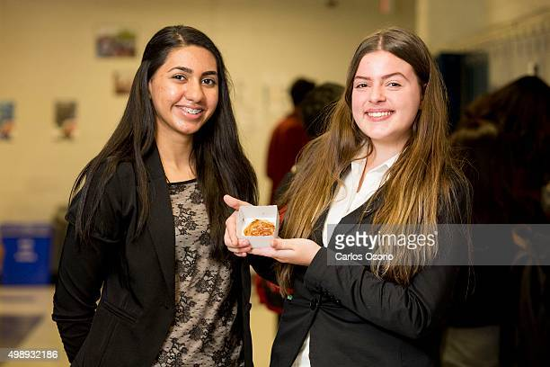 TORONTO ON NOVEMBER Grade 11 student Brittney Persaud 16yearsold and grade12 student Xhona Pulaj 17yearsold pose for a photo with their product an...