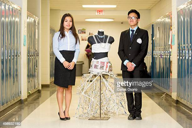 Grade 12 student Anika Peng, 17-years-old and grade 11 student Aiken Chau, 16-years-old pose for a photograph with their eco friendly dress made of...