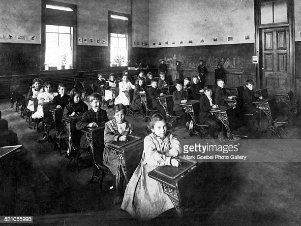 Grade school children in desks late 1880s or early 1890s