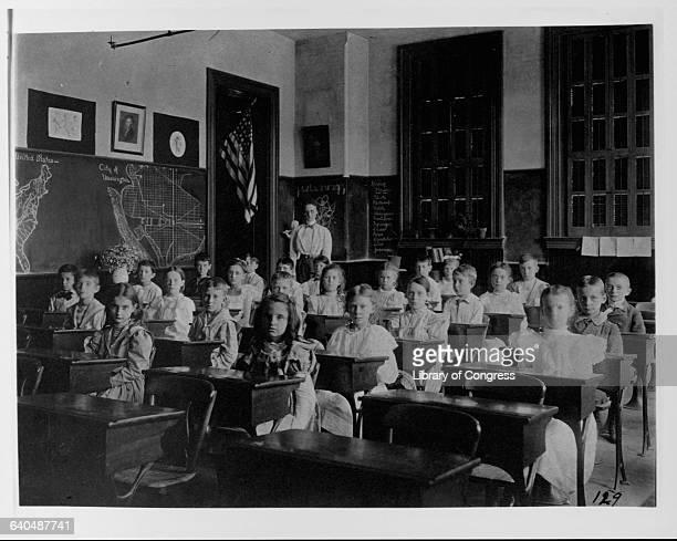Grade School Students Sitting in Classroom