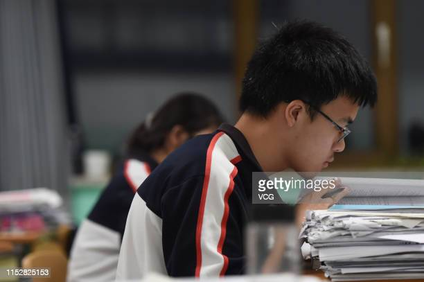 Grade three senior high school students study for the upcoming 2019 National College Entrance Exam or Gaokao during a night self study session on May...