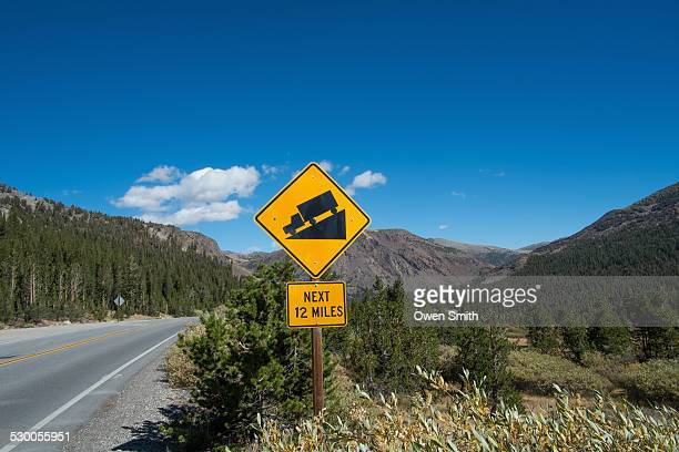 gradient warning sign on highway 140, yosemite national park, california, usa - steep stock pictures, royalty-free photos & images