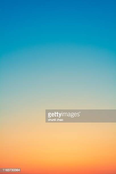 gradual color of the sky at sunset - arancione foto e immagini stock