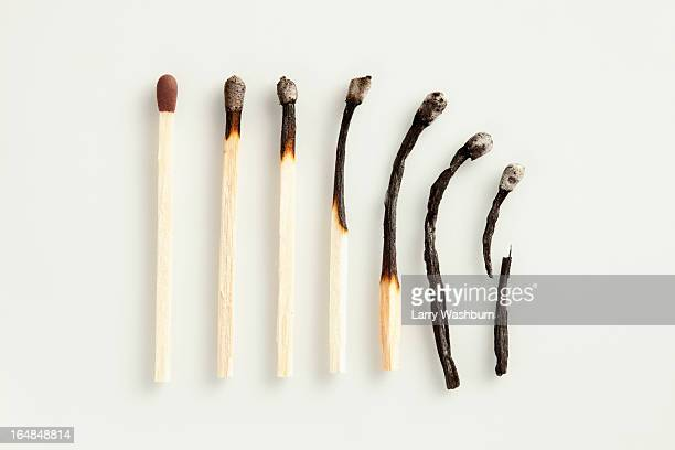 a gradual decline of matches - fiammifero foto e immagini stock