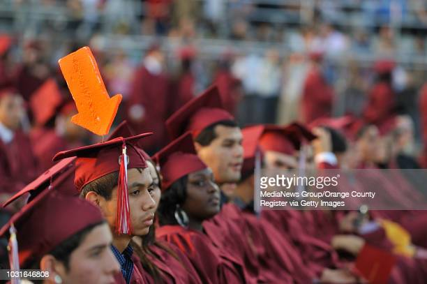 DOWNEY CA Graduate Alexander Anaya dons a giant arrow during the commencement ceremony at Downey High School on June 18 2009 Photo by