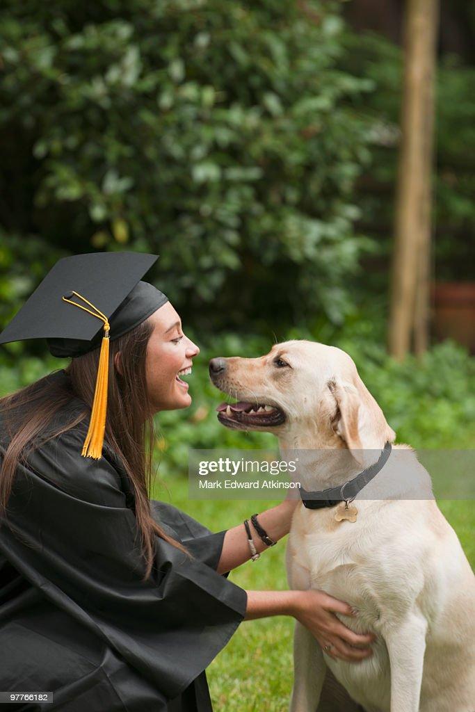 Graduate and dog : Stock Photo