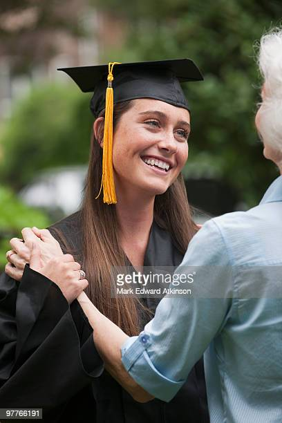 Graduate and elderly woman