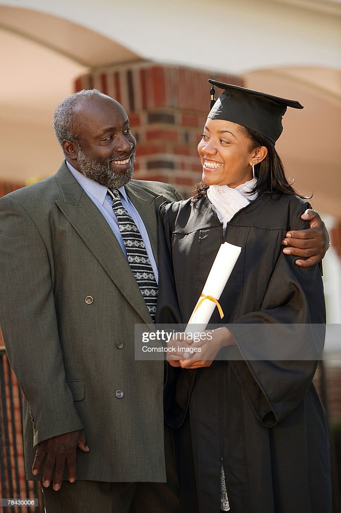 Graduate and father : Stockfoto