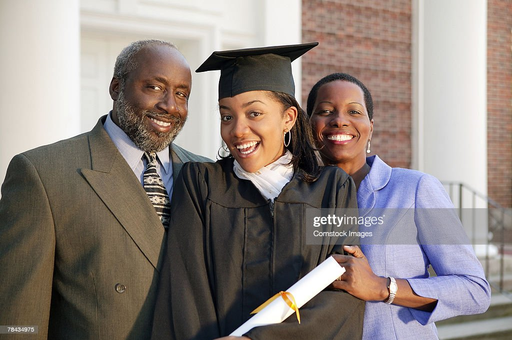 Graduate and parents : Stockfoto