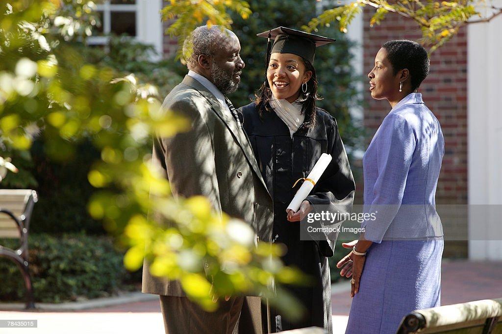 Graduate and parents : Stock Photo