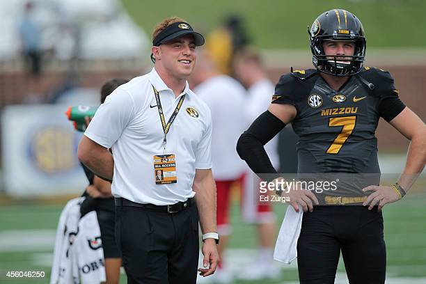 Graduate assistant Austyn CartaSamuels talks with quarterback Maty Mauk of the Missouri Tigers prior to a game against the Indiana Hoosiers at...