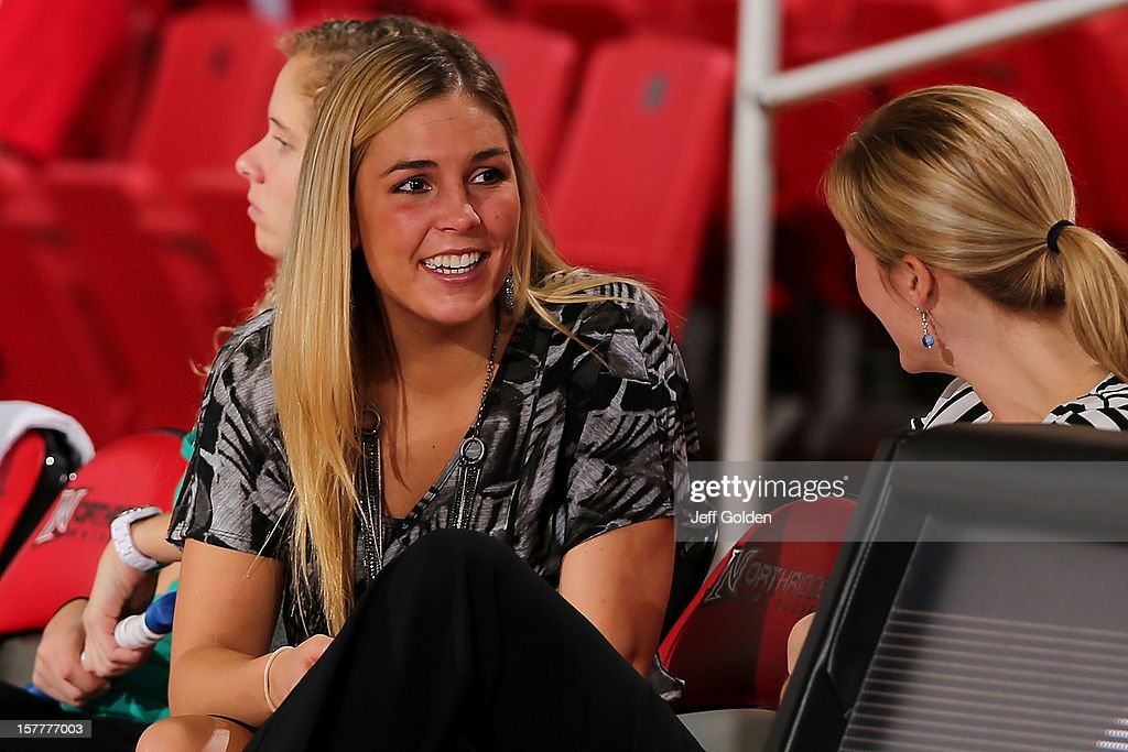Graduate assistant coach Brittany Burkhardt of the Detroit Titans smiles as she talks to assistant coach Emily Geary before the game against the South Alabama Jaguars at The Matadome on November 24, 2012 in Northridge, California. South Alabama defeated Detroit 59-56.