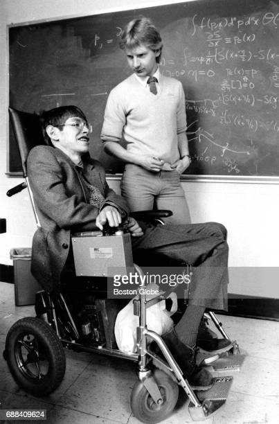Graduate assistant Colin P Williams talks with physicist Stephen Hawking at Harvard University in Cambridge MA on Apr 12 1984