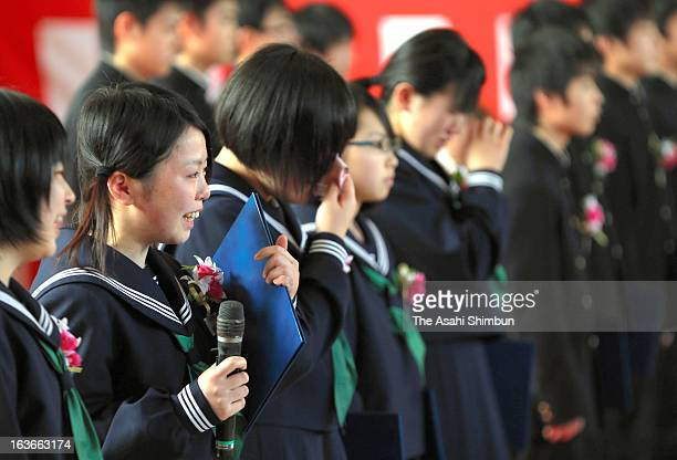 A graduate from Namie Junior High school originally located within the evacuation zone addresses during the graduation ceremony at the temporary...
