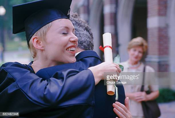 Graduate hugging her father