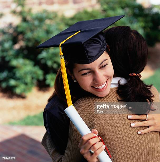 graduate hugging mother - diploma stock pictures, royalty-free photos & images
