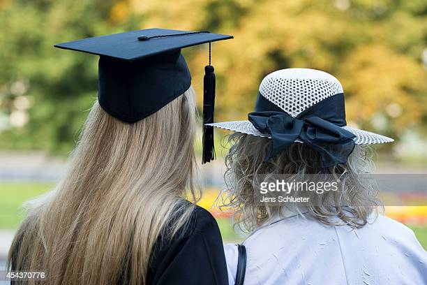 Graduate in gown and caps and his mother celebrate their graduation at the HHL Leipzig Graduate School of Management on August 30 2014 in Leipzig...