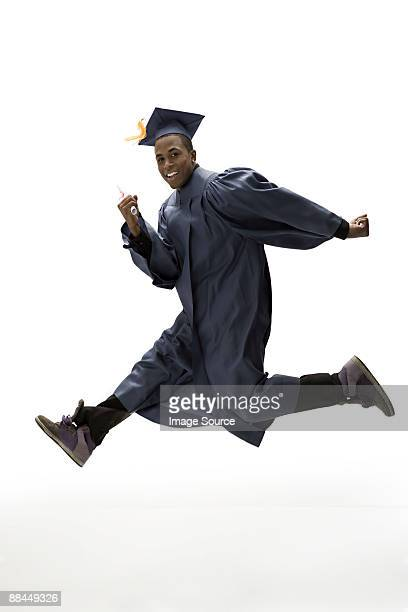 graduate jumping - mortar board stock pictures, royalty-free photos & images