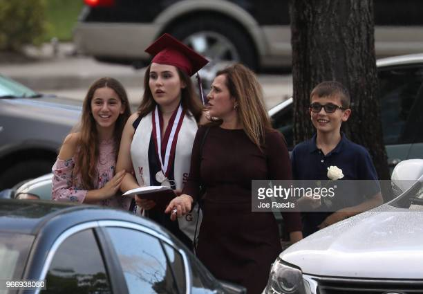 A graduate of Marjory Stoneman Douglas High School heads to her car after attending the graduation ceremony at the BBT Center on June 3 2018 in...