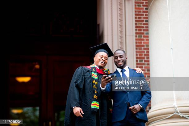 Graduate poses for a selfie during Harvard's 368th commencement ceremony at Harvard University in Cambridge, Massachusetts, on May 30, 2019.